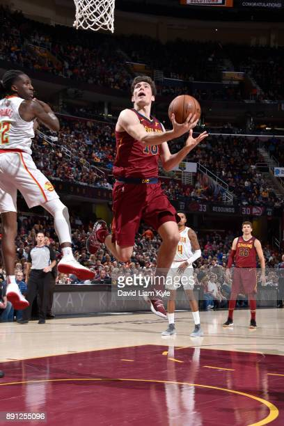 Cedi Osman of the Cleveland Cavaliers shoots a lay up against the Atlanta Hawks on December 12 2017 at Quicken Loans Arena in Cleveland Ohio NOTE TO...