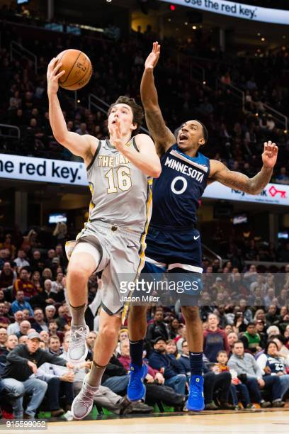 Cedi Osman of the Cleveland Cavaliers shoots over Jeff Teague of the Minnesota Timberwolves during overtime at Quicken Loans Arena on February 7 2018...