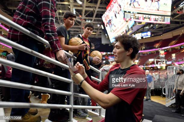 Cedi Osman of the Cleveland Cavaliers signs autographs for fans before the game against the Atlanta Hawks on October 21 2018 at Quicken Loans Arena...