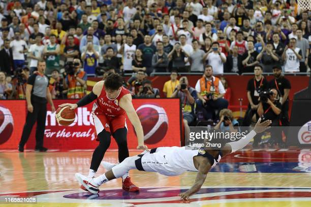 Cedi Osman of Turkey drives against Marcus Smart of USA during the 1st round Group E match between USA and Turkey of 2019 FIBA World Cup at the...