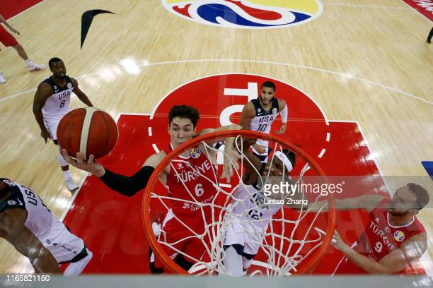 Cedi Osman of Turkey drives to basket against Myles Turner of USA during the 1st round Group E match between USA and Turkey of 2019 FIBA World Cup at...