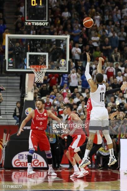 Cedi Osman of Turkey fouls on Jayson Tatum of USA at the last seconds during the 1st round match between USA and Turkey of 2019 FIBA World Cup at...
