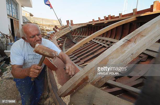 Cedomir Butina works on a traditional Croatian wooden boat named �gajeta� in his private small shipyard in the town of Betina on Murter island some...