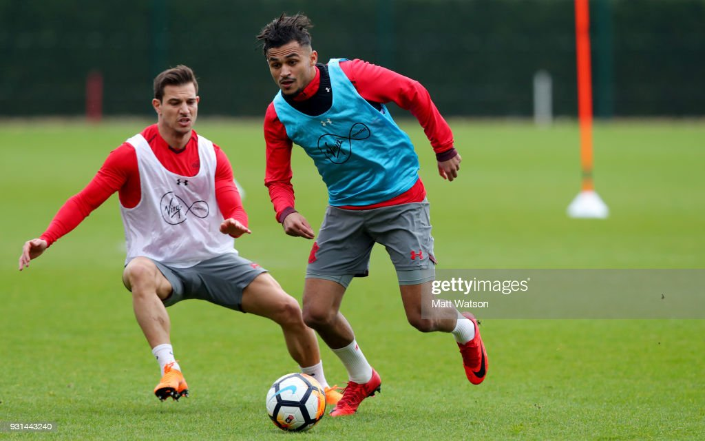 Cedric(L) and Sofiane Boufal during a Southampton FC training session at the Staplewood Campus on March 13, 2018 in Southampton, England.