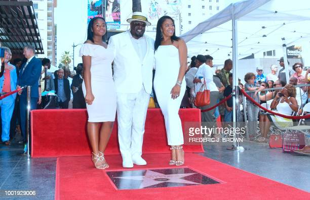 Cedric Antonio Kyles better known as Cedric The Entertainer poses with his wife and daughter on his Hollywood Walk of Fame Star is unveiled during a...