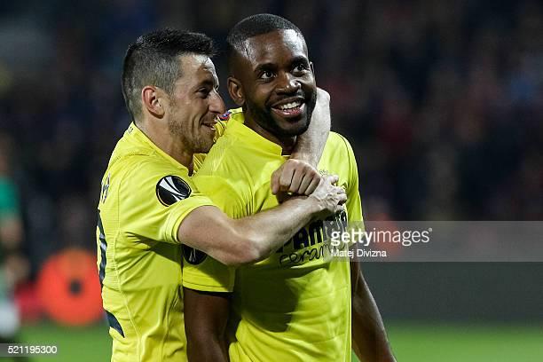 Cedric Bakambu and Antonio Rukavina of Villareal celebrate team's victory after the UEFA Europa League Quarter Final second leg match between Sparta...