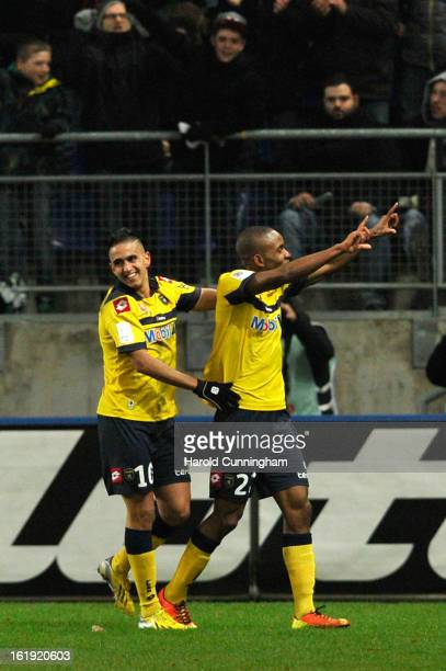 Cedric Bakambu is congratulated by Ryad Boudebouz of FC SochauxMontbeliard after scoring a goal during the French League 1 football match between FC...