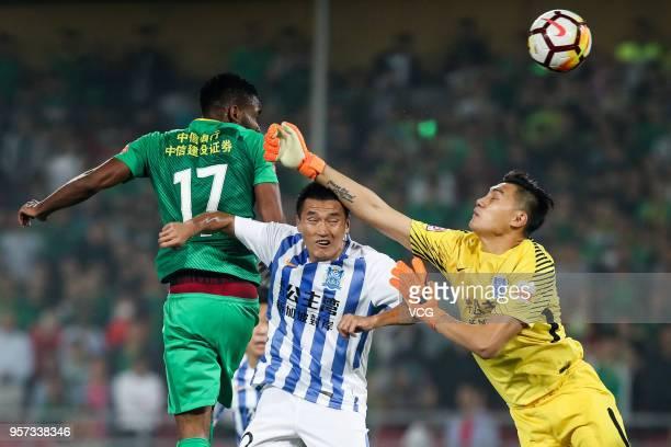 Cedric Bakambu of Beijing Guoan and goalkeeper Cheng Yuelei of Guangzhou RF compete for the ball during 2018 China Super League match between Beijing...