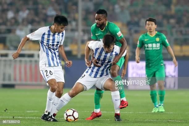 Cedric Bakambu of Beijing Guoan and Jiang Jihong of Guangzhou RF compete for the ball during 2018 China Super League match between Beijing Guoan and...