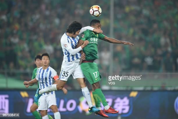 Cedric Bakambu of Beijing Guoan and Li Tixiang of Guangzhou RF compete for the ball during 2018 China Super League match between Beijing Guoan and...