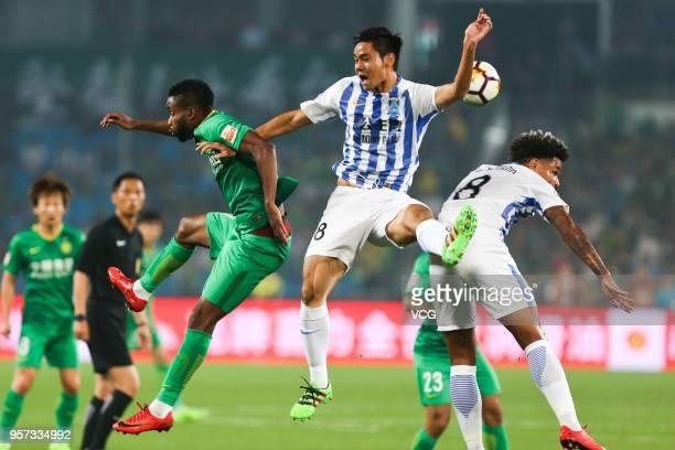 Cedric Bakambu of Beijing Guoan and Yi Teng of Guangzhou RF compete for the ball during 2018 China Super League match between Beijing Guoan and...