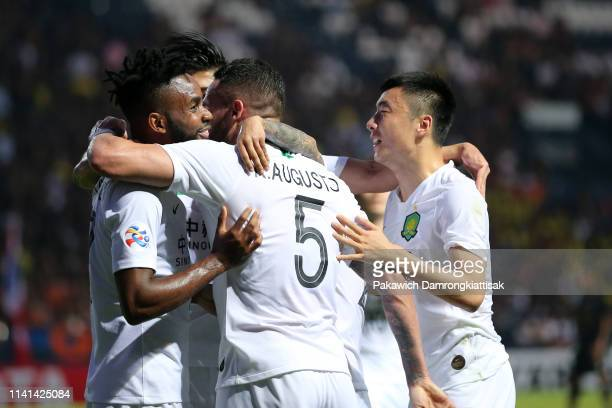 Cedric Bakambu of Beijing Guoan celebrates scoring his side's second goal with his team mates during the AFC Champions League Group G match between...