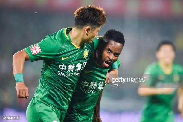 Cedric Bakambu of Beijing Guoan celebrates with team mate Yu Yang after scoring a goal during 2018 China Super League match between Beijing Guoan and...