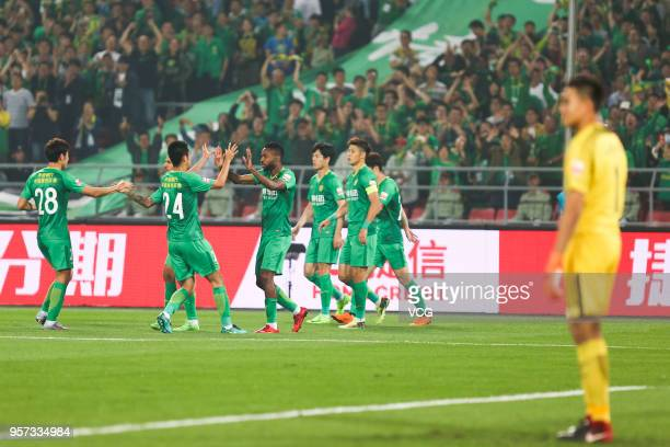 Cedric Bakambu of Beijing Guoan celebrates with team mates after scoring a goal during 2018 China Super League match between Beijing Guoan and...