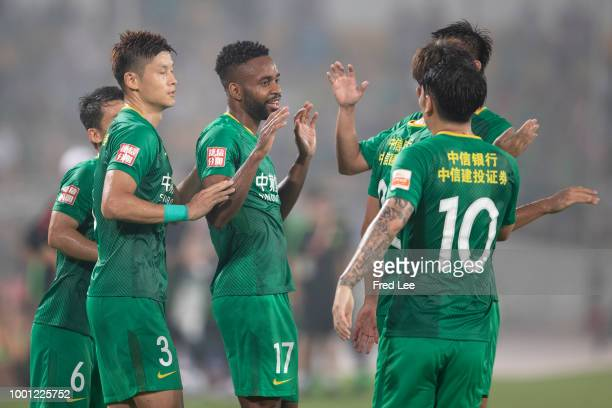 Cedric Bakambu of Beijing Guoan celebrates with teammates after scoring the second goal of his team during 2018 Chinese Super League between Beijing...