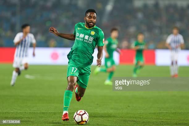 Cedric Bakambu of Beijing Guoan drives the ball during 2018 China Super League match between Beijing Guoan and Guangzhou RF at Beijing Workers...
