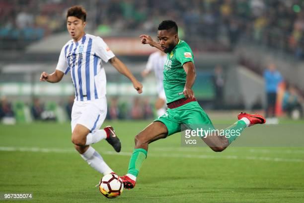 Cedric Bakambu of Beijing Guoan shoots the ball during 2018 China Super League match between Beijing Guoan and Guangzhou RF at Beijing Workers...