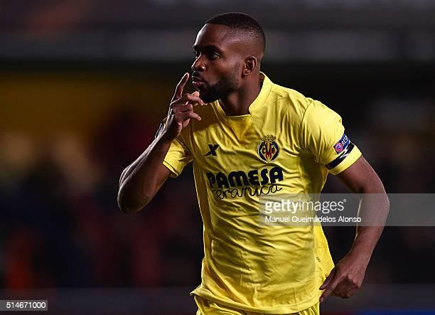 Cedric Bakambu of Villarreal celebrates scoring his team's first goal during the UEFA Europa League Round of 16 first leg match between Villarreal...
