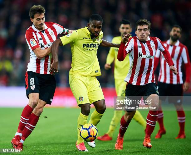 Cedric Bakambu of Villarreal CF competes for the ball with Ander Iturraspe and Inigo Cordoba of Athletic Club during the La Liga match between...