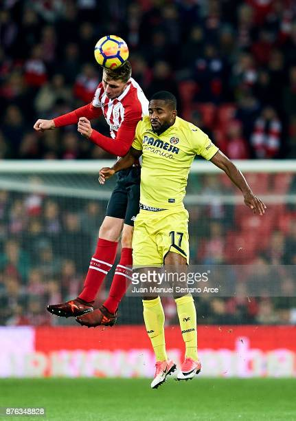 Cedric Bakambu of Villarreal CF competes for the ball with Aymeric Laporte of Athletic Club during the La Liga match between Athletic Club Bilbao and...