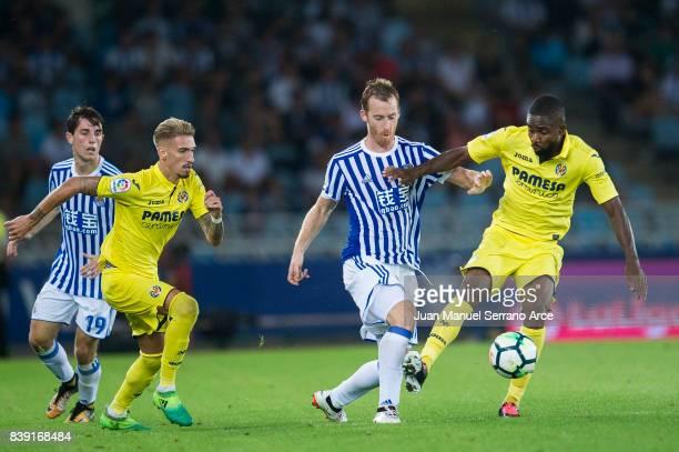 Cedric Bakambu of Villarreal CF duels for the ball with David Zurutuza of Real Sociedad during the La Liga match between Real Sociedad de Futbol and...