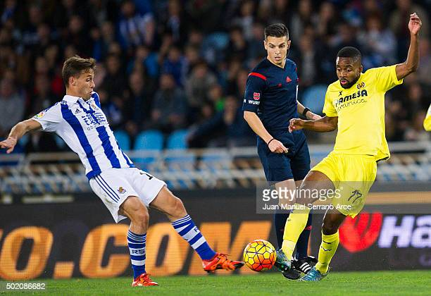 Cedric Bakambu of Villarreal CF duels for the ball with Sergio Canales of Real Sociedad during the La Liga match between Real Sociedad de Futbol and...