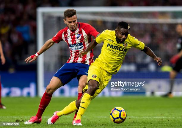 Cedric Bakambu of Villarreal CF fights for the ball with Saul Niguez Esclapez of Atletico de Madrid during the La Liga 201718 match between Atletico...