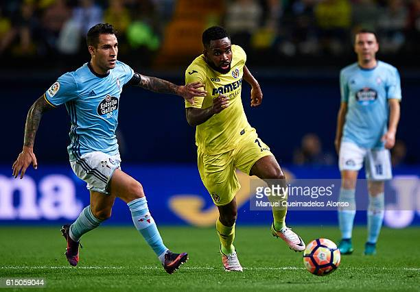 Cedric Bakambu of Villarreal competes for the ball with Hugo Mallo of Celta de Vigo during the La Liga match between Villarreal CF and Celta de Vigo...