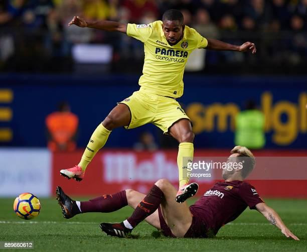Cedric Bakambu of Villarreal is tackled by Ivan Rakitic of Barcelona during the La Liga match between Villarreal and Barcelona at Estadio La Ceramica...
