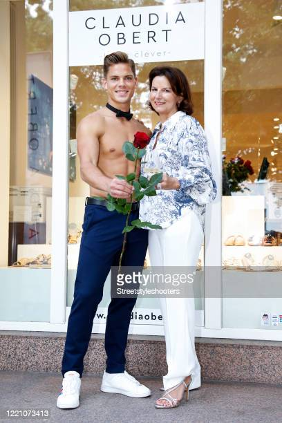 Cedric Beidinger and Claudia Obert host champagne happy hour in Claudia Obert's fashion store in Berlin on June 18, 2020 in Berlin, Germany.