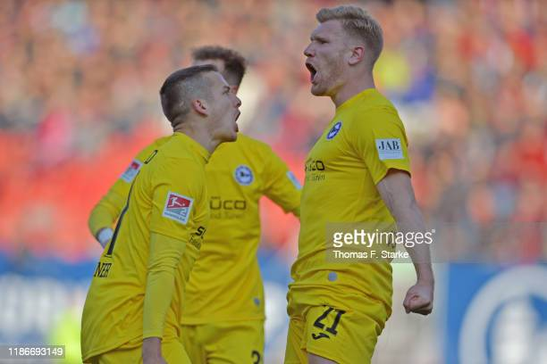Cedric Brunner and Andreas Voglsammer of Bielefeld celebrate their teams second goal during the Second Bundesliga match between 1 FC Nuernberg and...