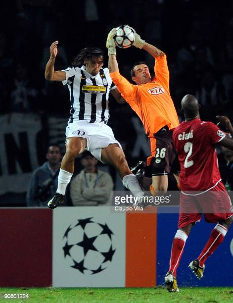 Cedric Carrasso of Bordeaux catches the ball in the air ahead of Amauri of Juventus FC during the UEFA Champions League Group A match between...