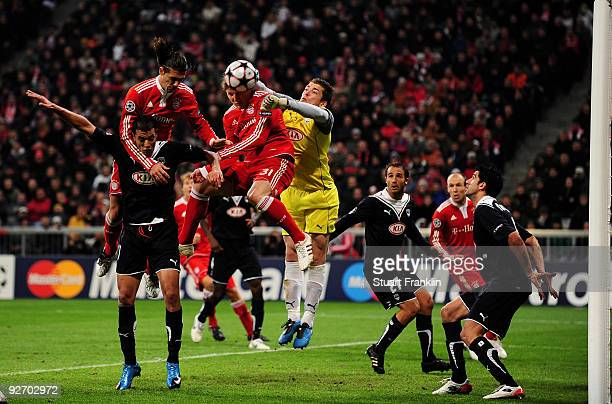 Cedric Carrasso of Bordeaux makes a save from Bastian Schweinstieger of Bayern during the UEFA Champions League Group A match between FC Bayern...
