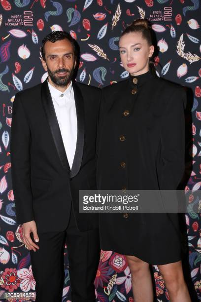 Cedric Charbit and Mathilde Pinault attend the Harper's Bazaar Exhibition as part of the Paris Fashion Week Womenswear Fall/Winter 2020/2021 At Musee...