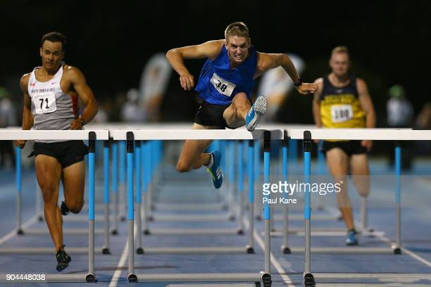 Cedric Dubler competes in the men's 100 metre hurdles during the Jandakot Airport Perth Track Classic at WA Athletics Stadium on January 13 2018 in...