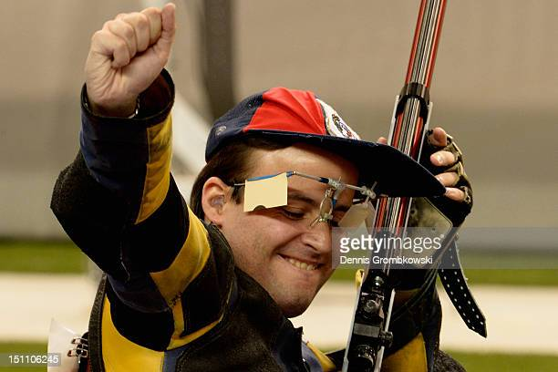 Cedric Fevre of France celebrates after winning the Mixed R3-10m Air Rifle Prone SH1 finals on day 3 of the London 2012 Paralympic Games at The Royal...