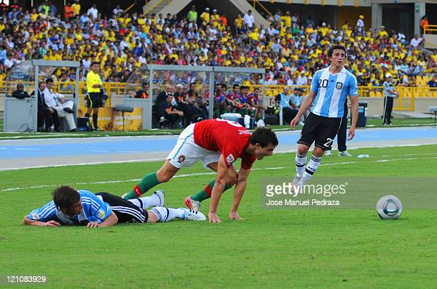 Cedric form Portugal fighst for the ball with Nicolas Tagliafico from Argentina during the match between Argentina and Portugal as part of the U20...