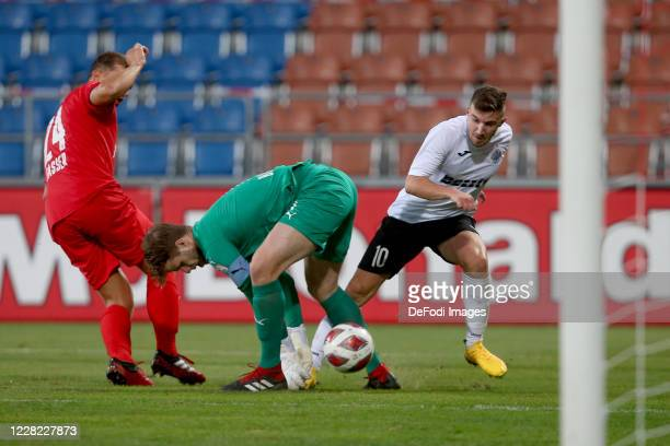 Cedric Gasser of FC Vaduz, goalkeeper Benjamin Buechel of FC Vaduz and Jurgen Degabriele of Hibernians FC battle for the ball during the UEFA Europa...
