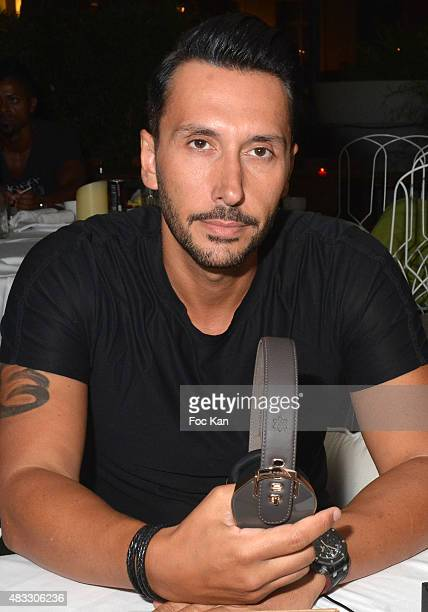 Cedric Gervais poses with new Pryma headset during the Cedric Gervais DJ Set Party at the VIP Room Saint Tropez on August 6 2015 in SaintTropez France