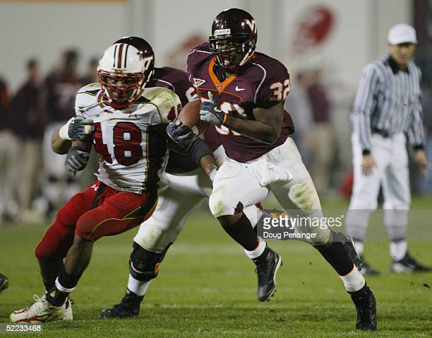 Cedric Humes of the Virginia Tech Hokies carries the ball against the Maryland Terrapins during NCAA football at Lane Stadium on November 18 2004 in...