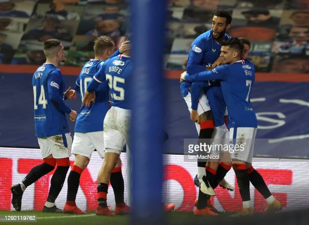 Cedric Itten of Rangers celebrates with Connor Goldson and Ianis Hagi after scoring their team's second goal during the Ladbrokes Scottish...