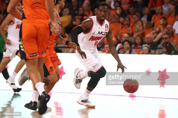 Cedric Jackson dribbles during the round eight NBL match between the Cairns Taipans and the Illawarra Hawks at Cairns Convention Centre on December...