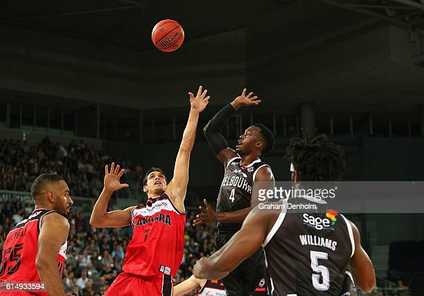 Cedric Jackson of Melbourne United and Oscar Forman of the Illawarra Hawks compete in the air during the round two NBL match between Melbourne United...
