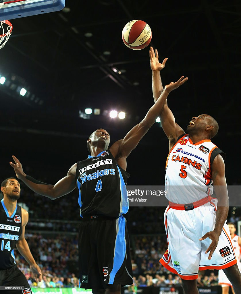 Cedric Jackson of the Breakers (L) and Jamar Wilson of the Taipans compete for the ball during the round 11 NBL match between the New Zealand Breakers and the Cairns Taipans at Vector Arena on December 13, 2012 in Auckland, New Zealand.