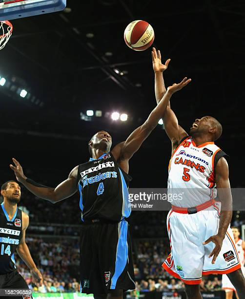Cedric Jackson of the Breakers and Jamar Wilson of the Taipans compete for the ball during the round 11 NBL match between the New Zealand Breakers...