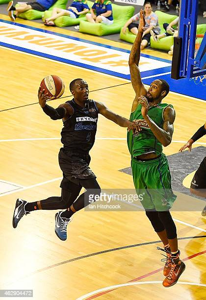Cedric Jackson of the Breakers attempts a layup past Mickell Gladness of the Crocodiles during the round 18 NBL match between the Townsville...