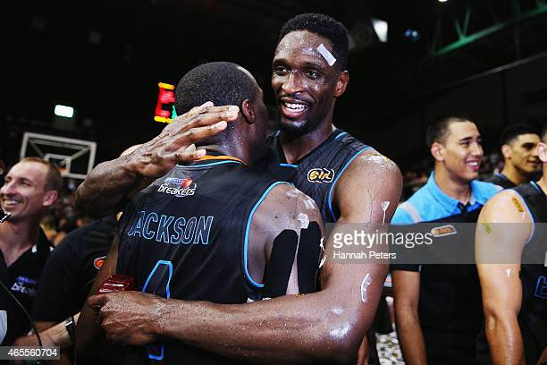 Cedric Jackson of the Breakers celebrates with Ekene Ibekwe of the Breakers after winning game two of the NBL Grand Final series between the New...