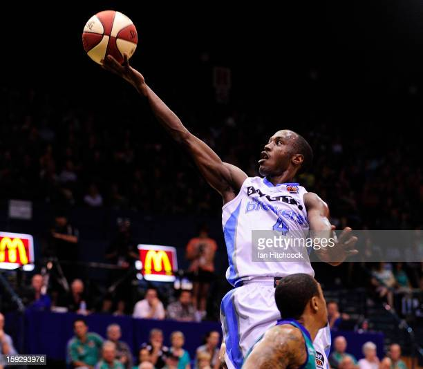 Cedric Jackson of the Breakers leaps over Gary Ervin of the Crocodiles during the round 14 NBL match between the Townsville Crocodiles and the New...