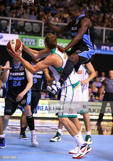 Cedric Jackson of the Breakers rides the shoulders of Jacob Holmes of the Crocodiles during the round three NBL match between the New Zealand...