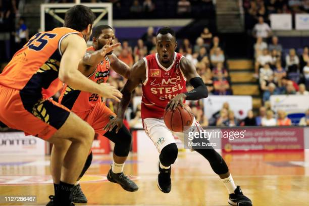 Cedric Jackson of the Hawks drives to the basket during the round 16 NBL match between the Illawarra Hawks and the Cairns Taipans at WIN...